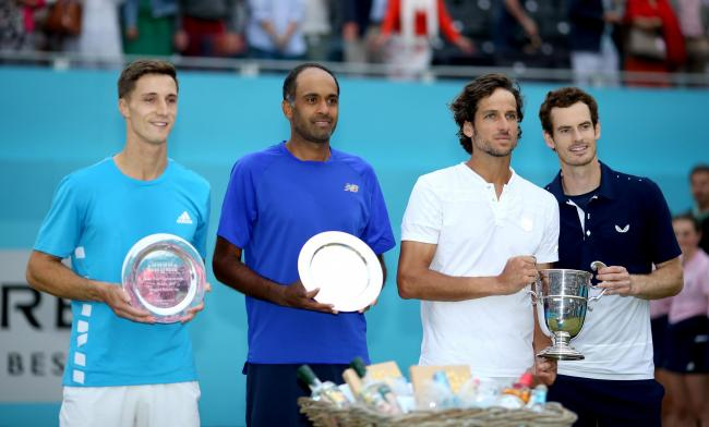 Andy Murray (right) and Feliciano Lopez (second right) celebrates victory in the Men's Doubles final with the trophy alongside runners-up Rajeev Ram (second left) and Joe Salisbury (left) (Photo credit : Steven Paston/PA Wire)