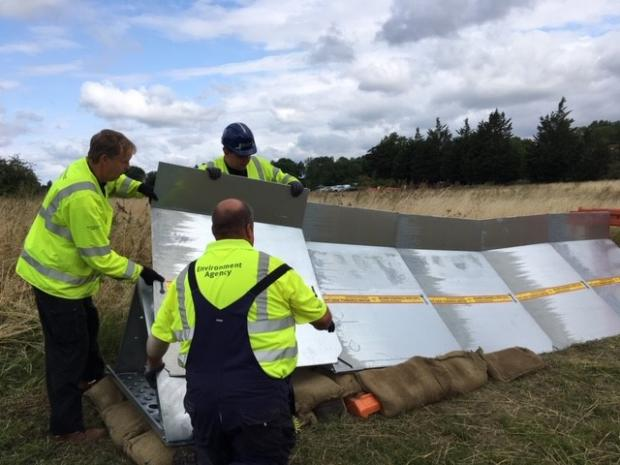 Surrey Comet: EA workers test temporary flood defences in Chertsey on Wednesday, July 31. Image: EA