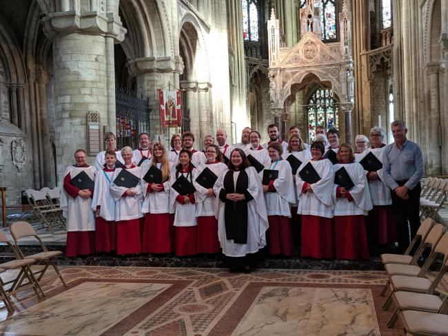 Vicar Katie Thomas and the choir of St James Church, New Malden, in Peterborough Cathedral