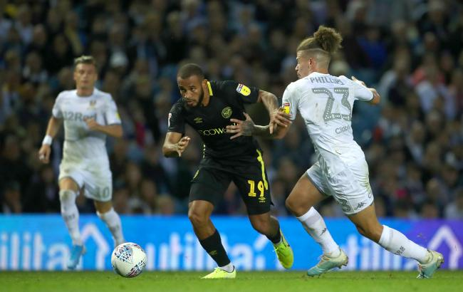 Brentford's Bryan Mbeumo (centre) and Leeds United's Kalvin Phillips (right) battle for the ball during the Sky Bet Championship match at Elland Road, Leeds.