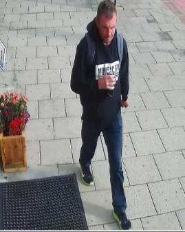 Police have released an image of a man they want to speak to in relation to the arson attack at a hairdressers on September 7.