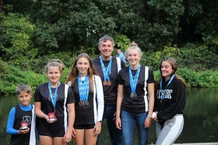 Addlestone Canoe Club Medalists — William, Emily, Hannah, Doug, Becky and Zoey. Image: ACC