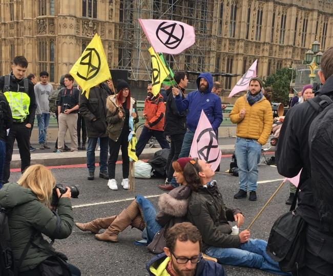 Protestors from Kingston XR locked themselves together as activists demanding emergency measures to reduce carbon emissions occupied Westminster Bridge Monday (October 7). Image: Joanna Haigh