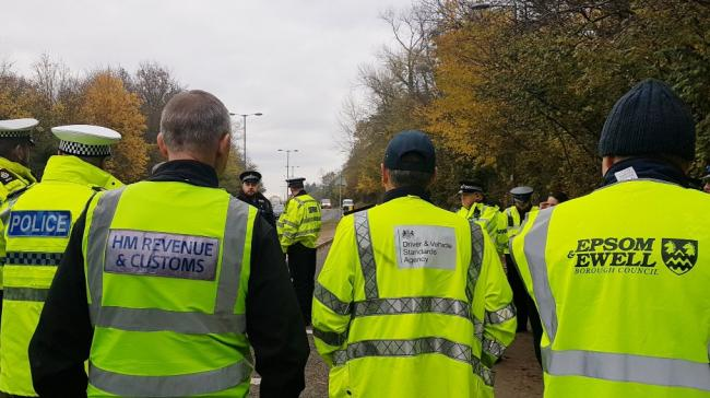 Surrey Police, HMRC, DVSA and EEBC workers at traffic stops on Wednesday. Image via Twitter