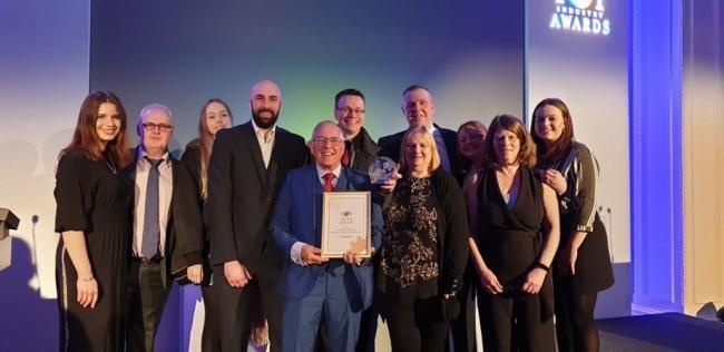 Toy Barnhaus staff with their award. Image via Ashley Centre Epsom