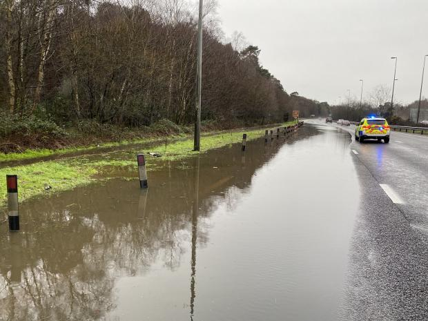 Surrey Comet: Flooding on A3 near Ockham brought road closures. Image: Surrey RPU via Twitter.