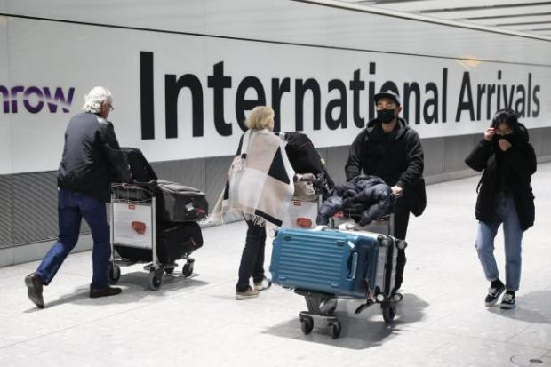Passengers arrive at Heathrow Airport