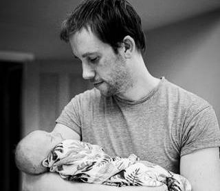 Kevin Baulcomb with baby Mabel. Image: NHS Surrey Heartlands