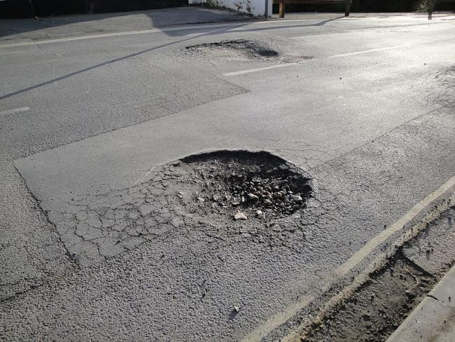 Surrey will receive millions of pounds from central government to fund pothole repairs. Image via commons.wikimedia