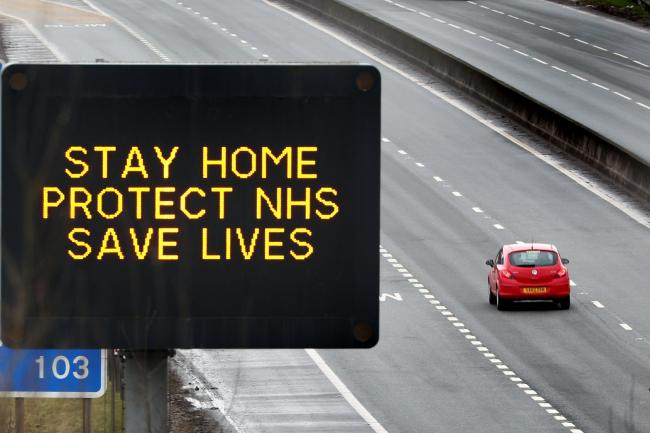 A motorway sign advising drivers to stay home, protect the NHS and save lives