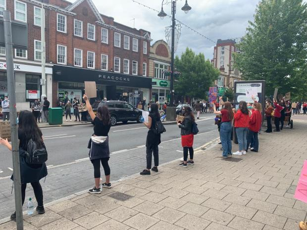 Surrey Comet: Socially distanced protesters line New Malden High Street in support of Black Lives Matter. Image: Henry Riley
