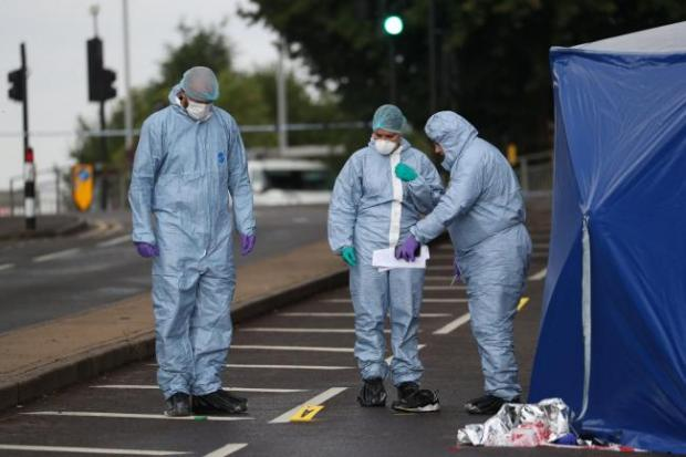 "Surrey Comet: Police and forensics on Moor Lane in Chessington following a hit-and-run incident where a man died after being ""dragged under a car"". Image: Steve Parsons/PA Wire"