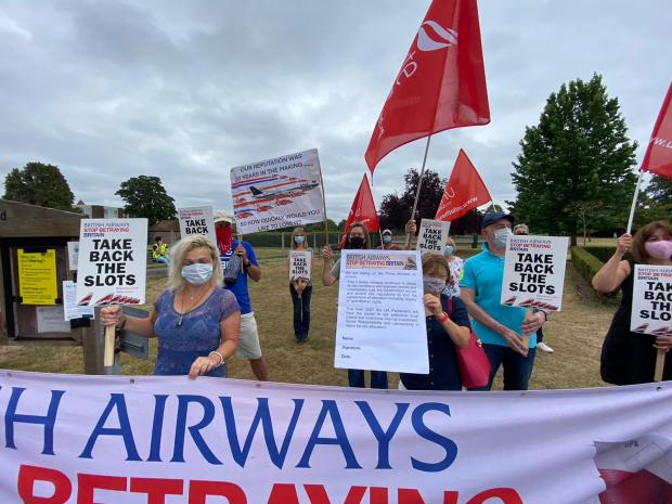 Surrey Comet: Protesters against British Airways' 'betrayal' of its employees wear masks and physically distance themselves at a protest in Weybridge. Image: Unite the Union