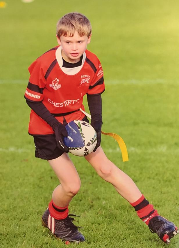 A young player enjoying community rugby at London Welsh rugby club before lockdown.