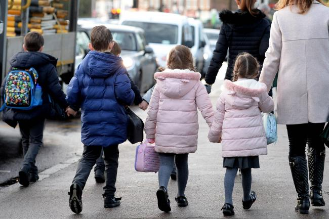 Children and parents walking to school