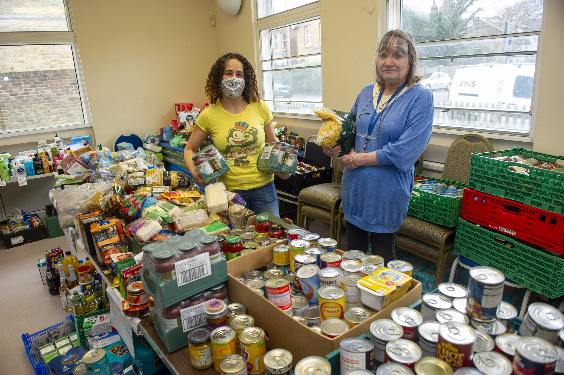 Piper Hall food bank feature with coordinator Jill Preston (Blue jumper/clear visor PPE) with helper Suzanne Seyghal.
