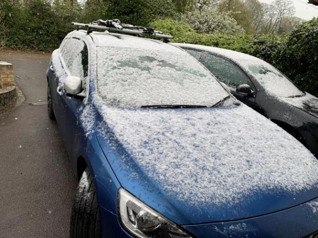 Surrey Comet: A light dusting of snow settles on a car. Peter Clifton/PA Wire.