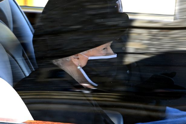 PA Wire - The Queen wipes a rear at the Duke of Edinburghs funeral