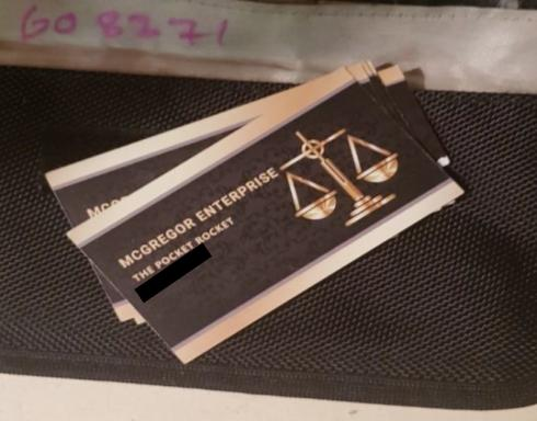 Surrey Comet: Image of the 'business cards' found by police.