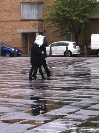 Lee Dyer hid his face as he left court with his girlfriend