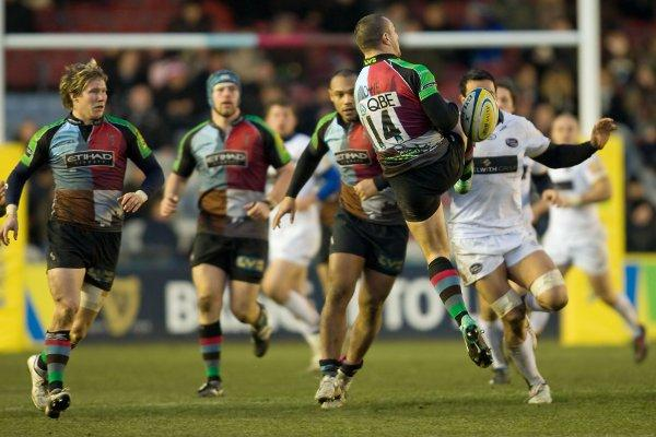 Moving on up: Centre Ollie Smith, left, in one of only 11 appearances for Quins