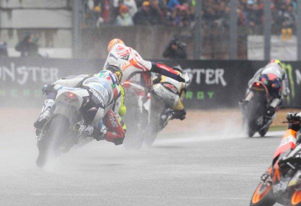 Slipping and sliding: Gino Rea, centre, struggles to keep his bike upright before a crash with Johann Zarco ended his first race at Le Mans. Picture: Graham Holt
