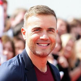 Gary Barlow will receive an OBE for services to the entertainment industry and to charity