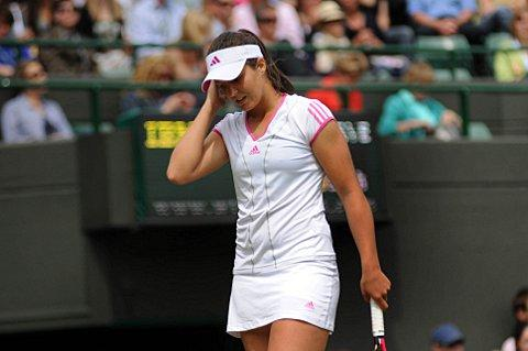 Bitter taste of defeat: Laura Robson lost in straight sets in the second round of the China Open    SP58726
