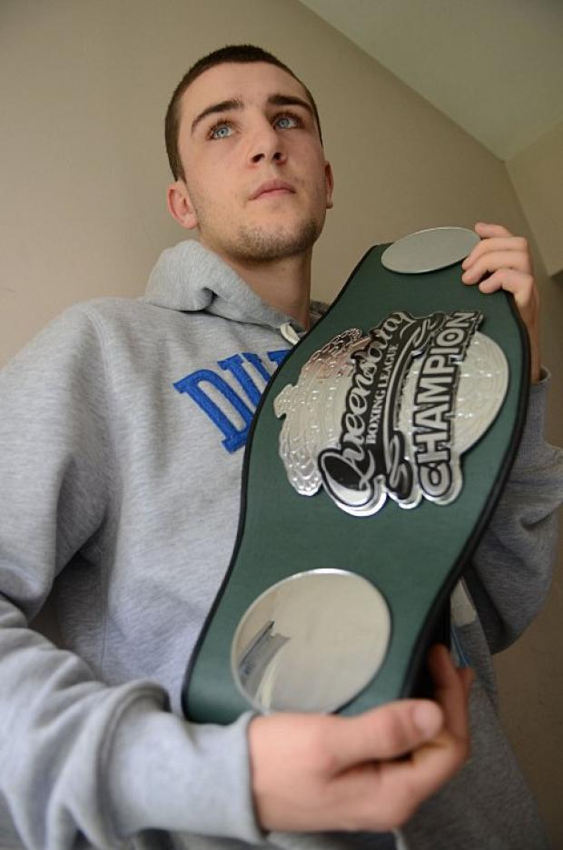 This belt's mine: Kingston's Danny Parsons with the Queensbury Boxing League southern area belt he retained in West Sussex last weekend