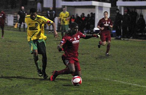 Surrey Comet: Going down? Robins' Michael Kamara takes a tumble in the 1-0 defeat to Thurrock, but are the Robins going to do the same      SP70819