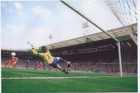 One moment in time: Dave Beasant makes history to deny Liverpool's John Aldridge from the penalty spot in the 1988 FA Cup Final     Photo: David McKnight