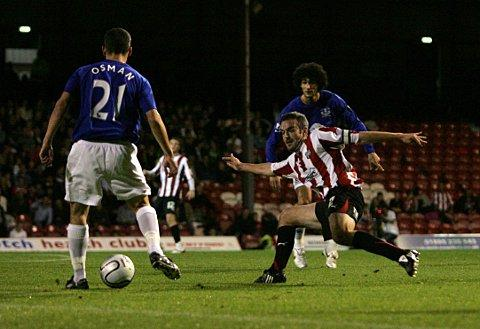 Flashback: Bees midfielder Kevin O'Connor had Everton's Leon Osman and Marouane Fellaini for company during his team's Carling Cup penalty shootout triumph over the Toffeemen in 2010. O'Connor would like Chelsea to field a similarly strong side 	B