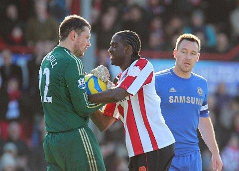 My ball: Clayton Donaldson, whose all action display unsettled the Chelsea defence, wrestles with Blues keeper Ross Turnbull