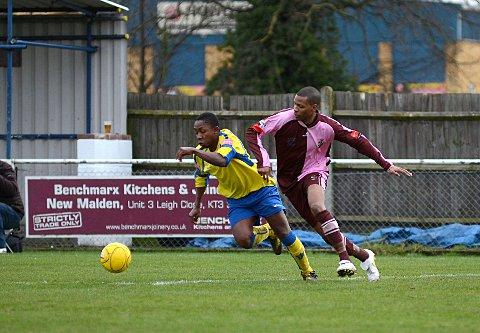 Competitive edge: Walton & Hersham's Victor Kiri and Corinthian Casuals' Danny Green battle for possession on Saturday