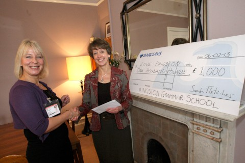 Support: Sarah Fletcher (right) hands over a cheque to Elaine Miller