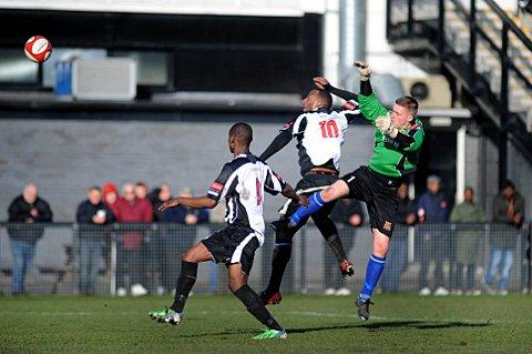 Crowded out: Tooting force the Three Bridges keeper into a rare bit of action on Saturday on their way to a disappointing defeat
