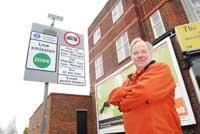 Sunny side of the street: Terry Dobbs, chairman of Worcester Park Traders' Association, at the LEZ boundary