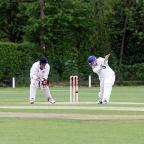 Hitting out: Wimbledon's James Bett makes runs against East Molesey