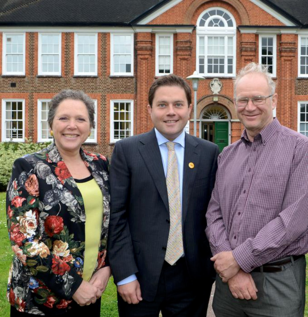 Former lead member for schools David Ryder-Mills, right, with ex-Lib Dem parliamentary candidate Robin Meltzer and former north Kingston MP Susan Kramer outside the soon to be Kingston Academy