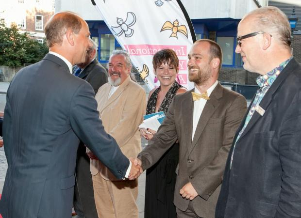 Surrey Comet: Prince Edward shakes hands with IYAF director Jeremy Sachs, alongside Rose chief executive Robert O'Dowd and fellow festival organisers
