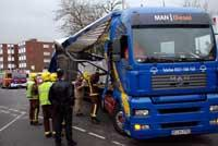 Surrey Comet: Emergency services survey the damage to the lorry Deadlinepix KT12844