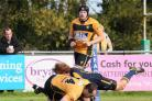 Try time: Esher's Andy Wright touches down for a try on Saturday