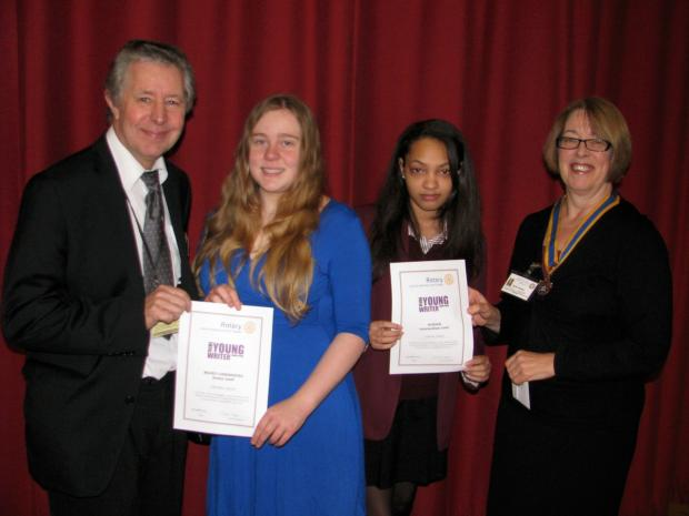 Charlotte Wilson and Cemein Fakhri collect their awards