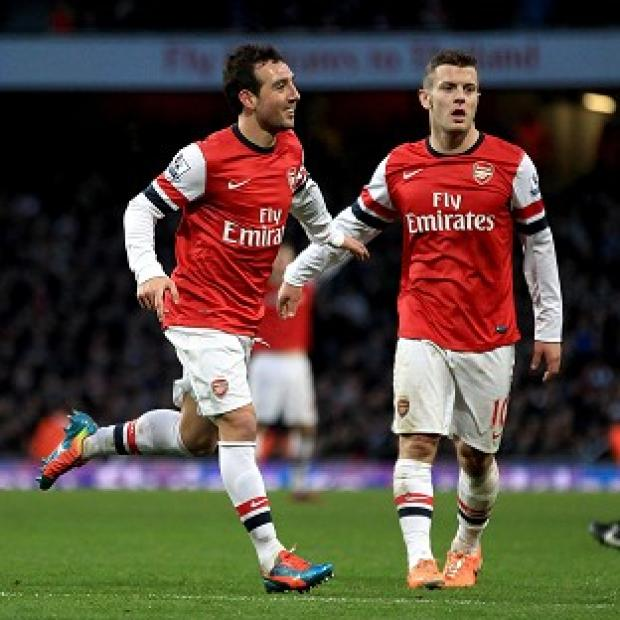 Surrey Comet: Santi Cazorla, left, scored a second-half brace to claim all three points for Arsenal