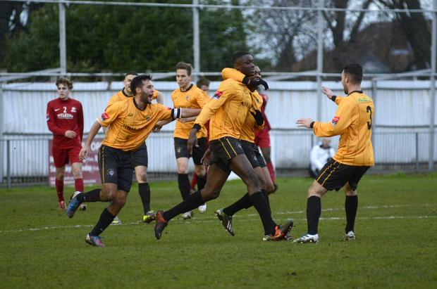 Tough day: Cray Wanderers celebrate Jide Maduako's opener in the 2-0 win over Carshalton Athletic