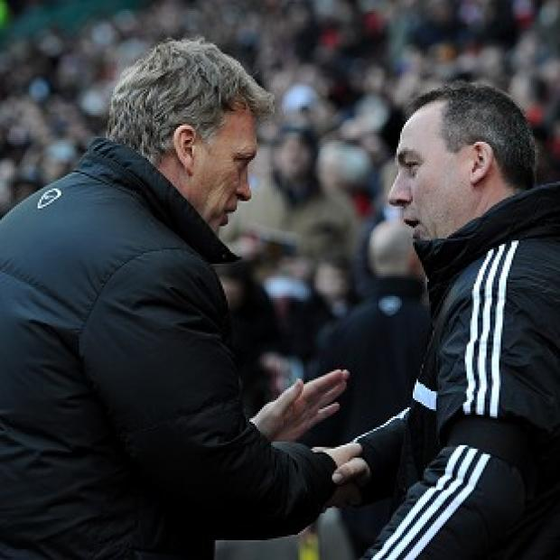 Surrey Comet: David Moyes, left, and Rene Meulensteen shake hands before the game