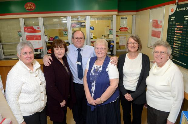Subpostmaster Peter Young, Nicola Simpkins, Debbie Stretch, Doreen Young, Denise Corbett and Caroline Noakes