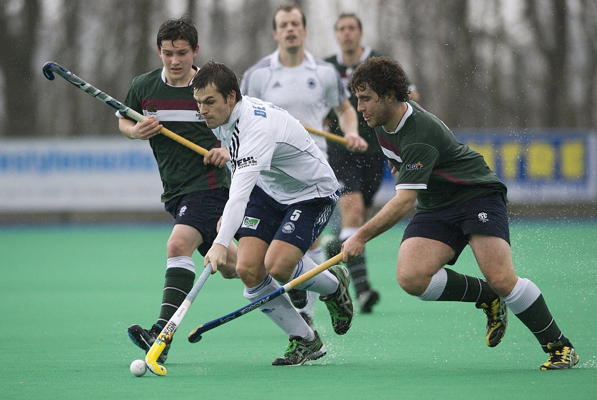 Secrets: Brett Garrard, right, in his hockey days for Surbiton