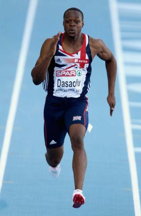 Pulled up: James Dasaolu was left clutching his left leg after winning the 60m final at the National Indoor Arena last weekend
