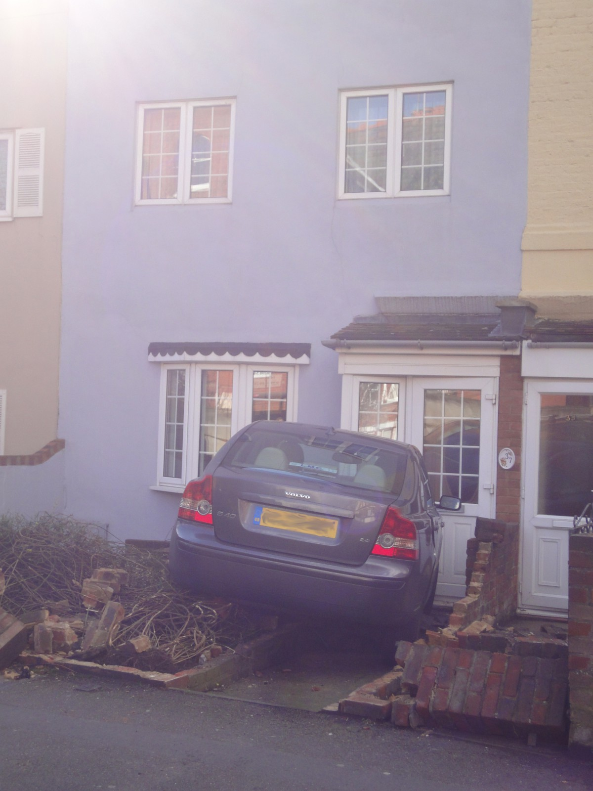 The car landed in a front garden in Park Street on Saturday. Picture by Caroline Scott